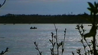 Fishermen in canoes at the opening of the Moisie river