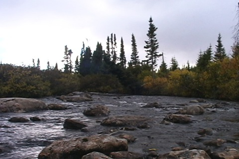 at the foot of the rapids