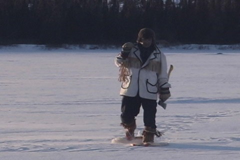 he walks across a frozen lake