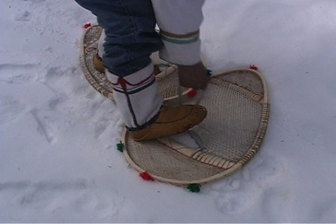 he puts on his snowshoes