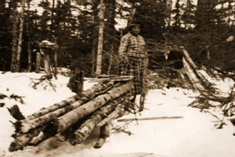 here she comes with her firewood on the sled