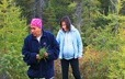 Evelyne St-Onge and her granddaughter, Laura Pinette, take a walk in the bush