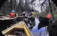 Group of Innu in canoes near a beaver dam