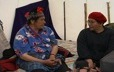 Inside a tent, an elder from Natashquan talks with Evelyne St-Onge