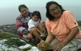 An elder from Ekuanitshit teaches her grandchildren some of her knowledge of plants