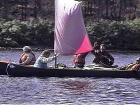 Groups of Innu in canoes with sails