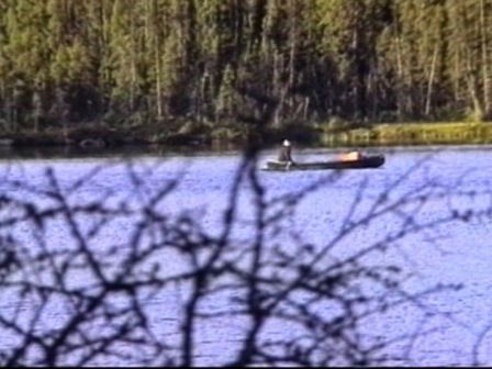 Angling in a canoe by a lake