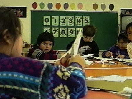 Innu children perform manual tasks in a school in Unaman-shipu
